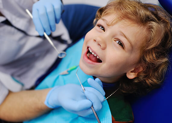 Happy child in dental chair